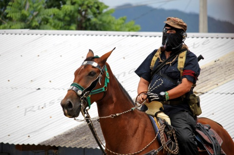 Subcomandante Insurgente Marcos Appears on Horseback in La Reali